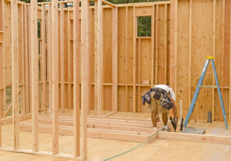 Framing building contractor framing up a wall section for a luxury custom house